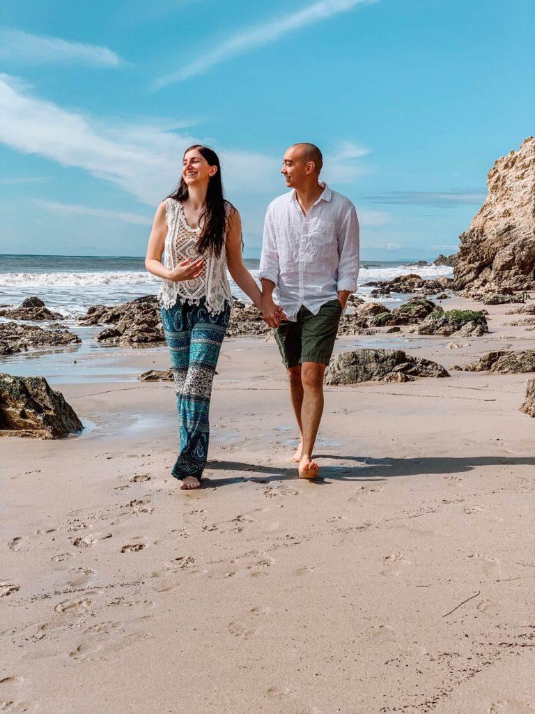 couple walking on the beach in california