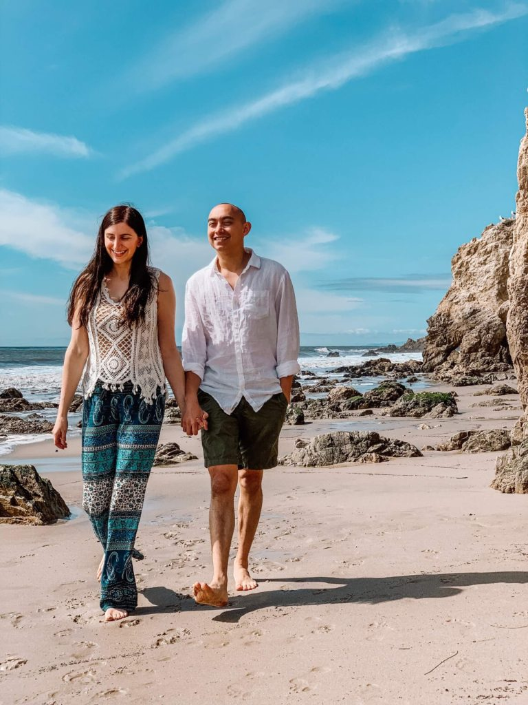 couple walking on the beach at el matador beach
