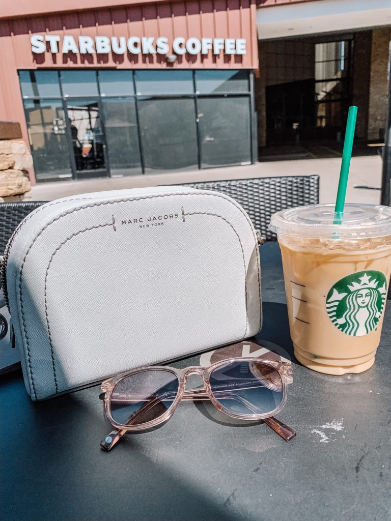 Warby Parker sunglasses in front of Starbucks